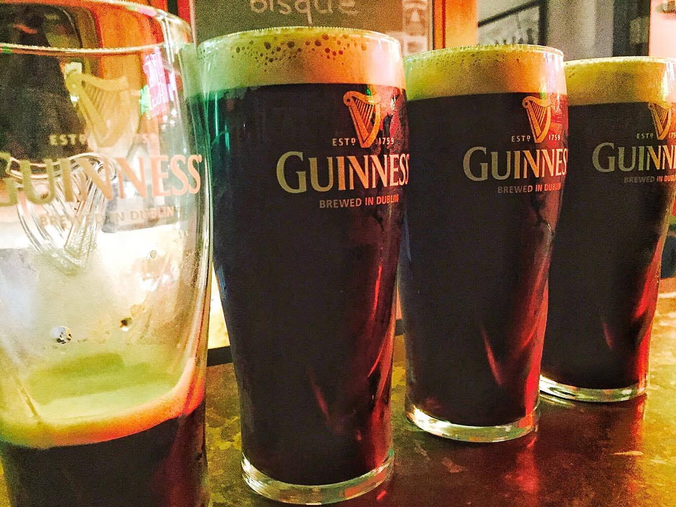 pints of guinness by Carrie Finnegan